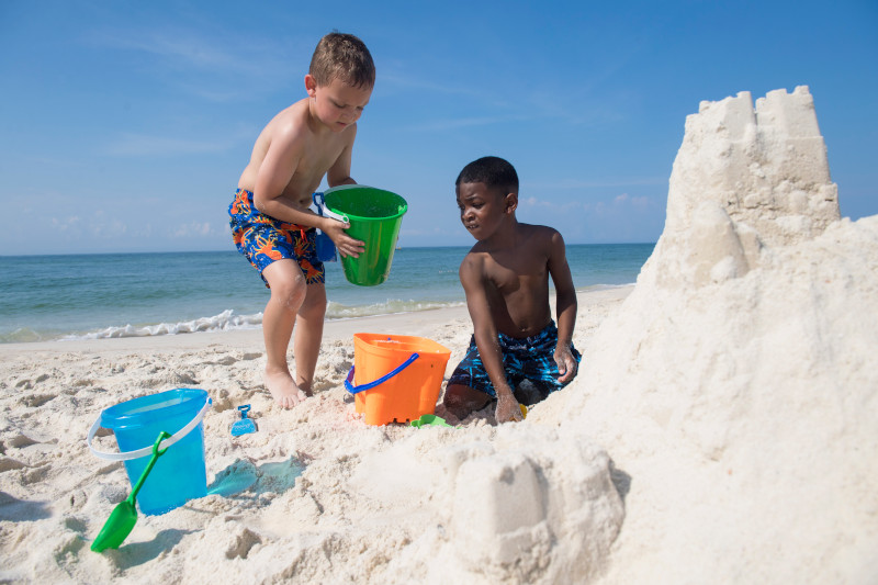 Kids building sandcastle in Orange Beach, AL