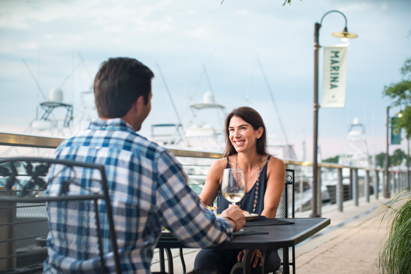 Couple dining at The Wharf in Orange Beach, AL