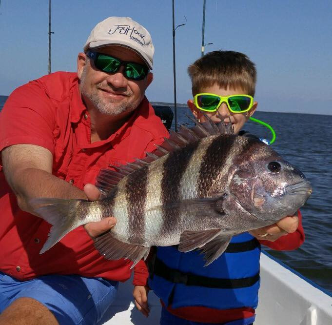 Father and son fish for sheepshead in Gulf Shores, AL