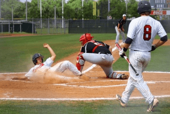 Baseball player slides into home plate
