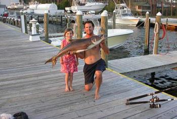 Dad and daughter with catch in Orange Beach