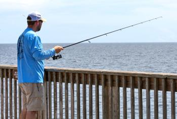 Man fishing from Gulf State Park pier in Gulf Shores
