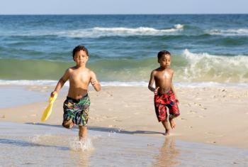 Kids running on the beach Gulf Shores Al