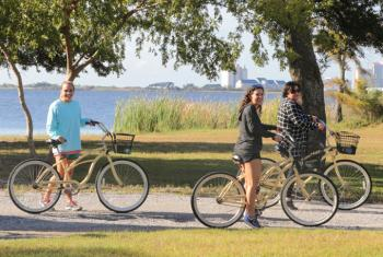 Women biking on Hugh S Branyon Backcountry Trail in Orange Beach