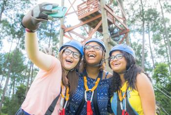 Girls take selfie at Hummingbird Zipline in Orange Beach