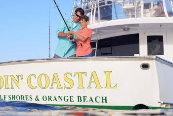 Dad and Son fishing on Orange Beach charter boat