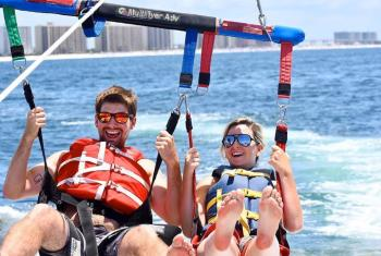 Couple parasailing in Gulf Shores
