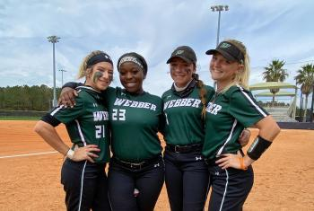 Softball players in Gulf Shores, AL