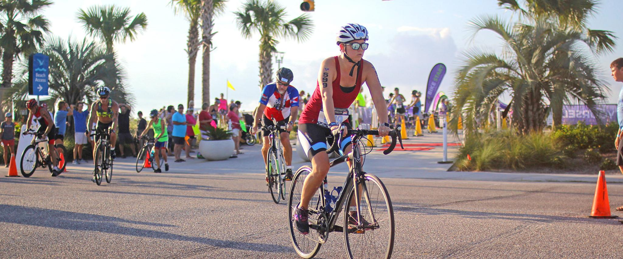 Bike riders compete in Alabama Coastal Triathlon in Gulf Shores AL