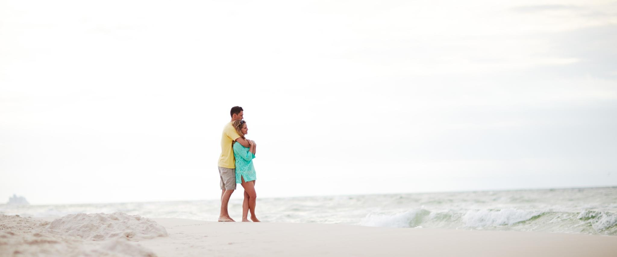 couple looking at the water in Orange Beach AL