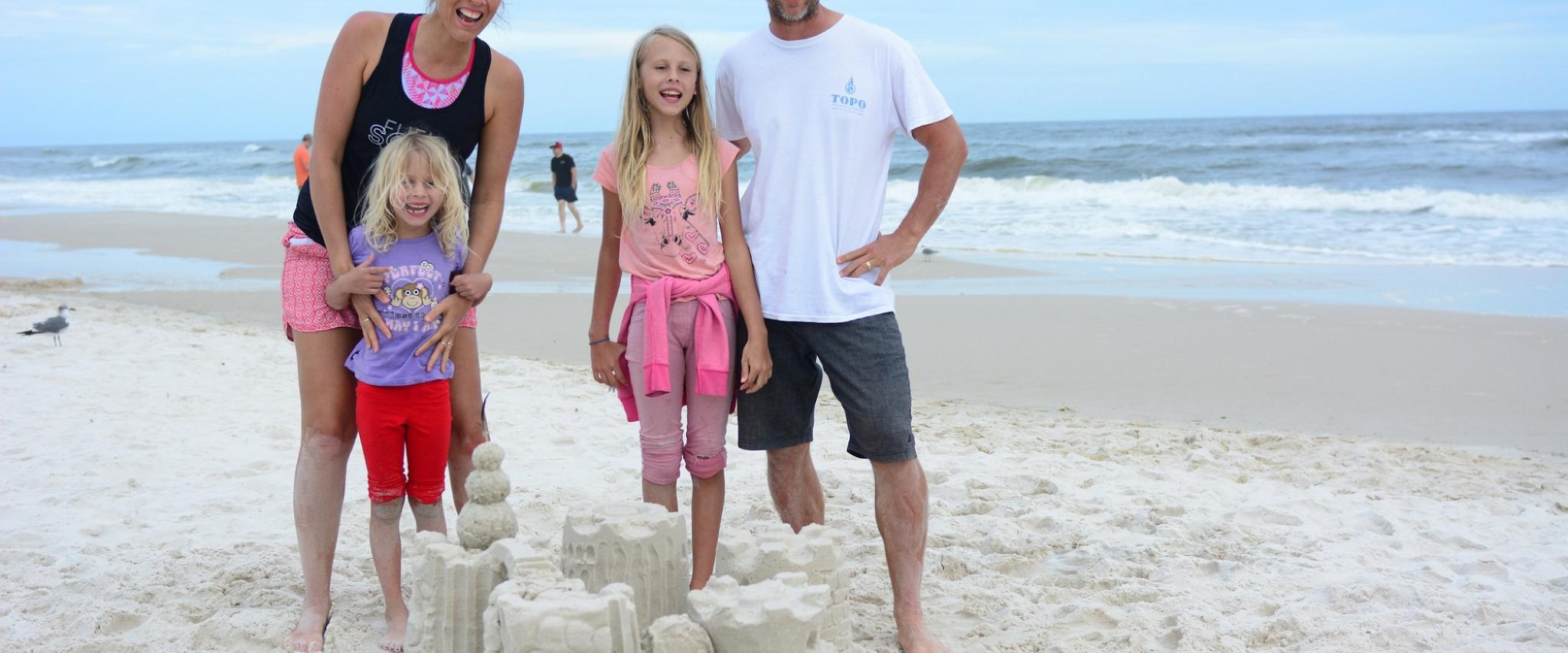 family on the beach in Gulf Shores AL