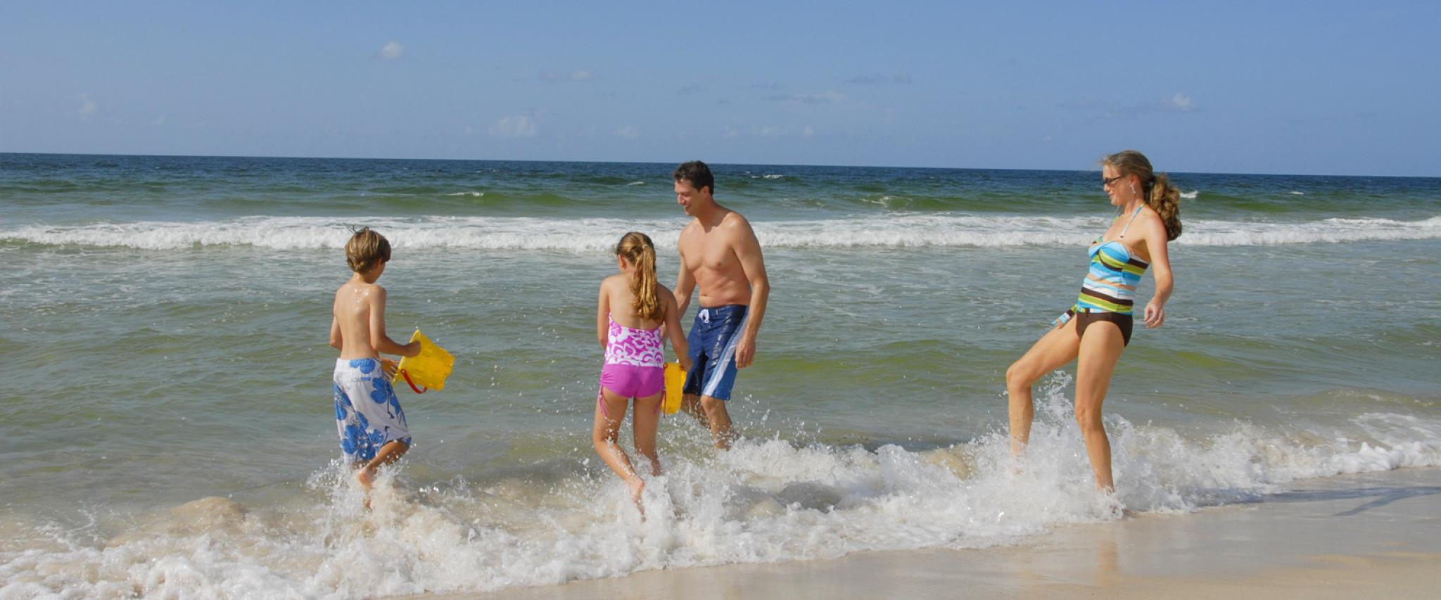 Family plays on Alabama's beaches