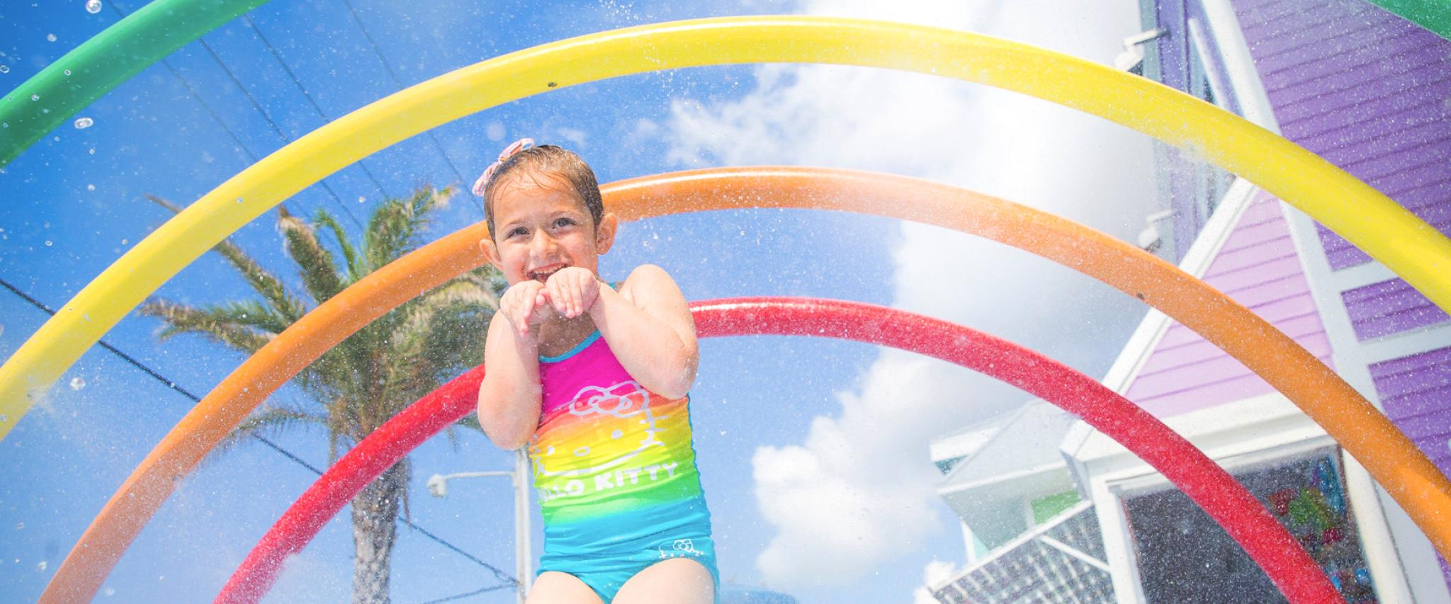 Girl plays at splash pad in Gulf Shores
