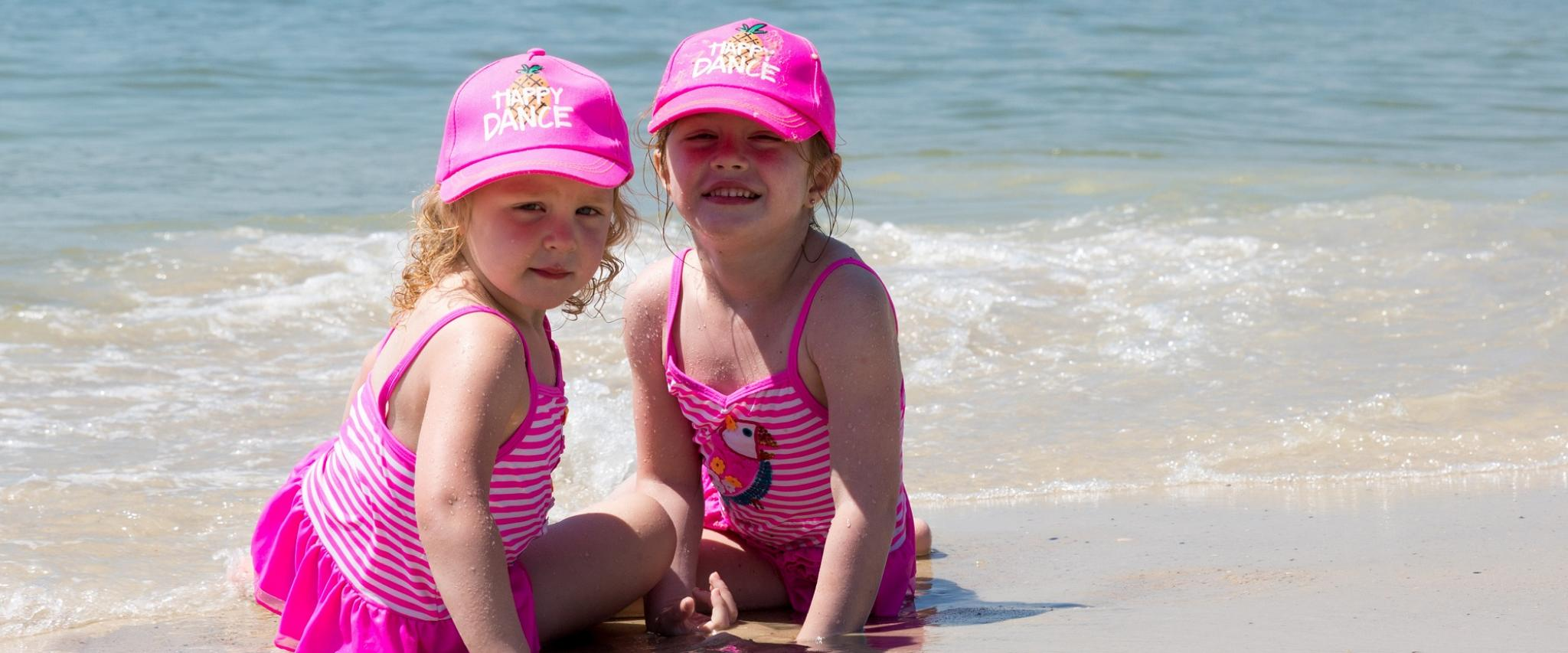 sisters on the beach in Gulf Shores AL