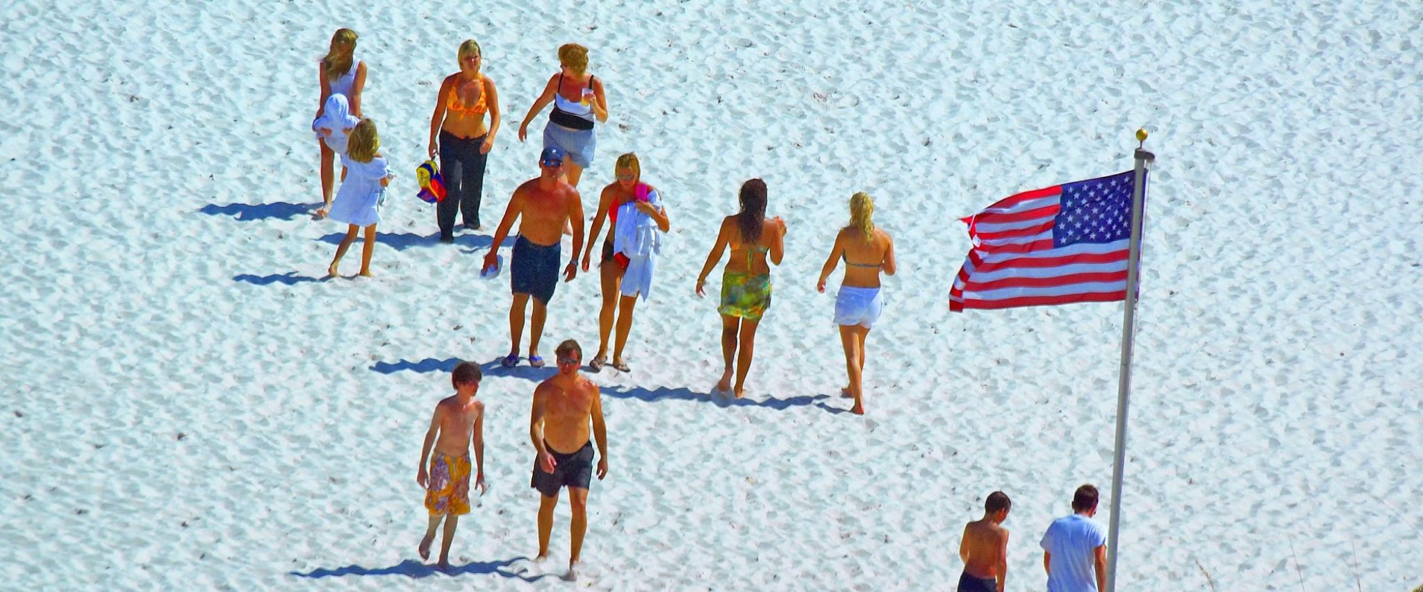 American flag and people on the beach