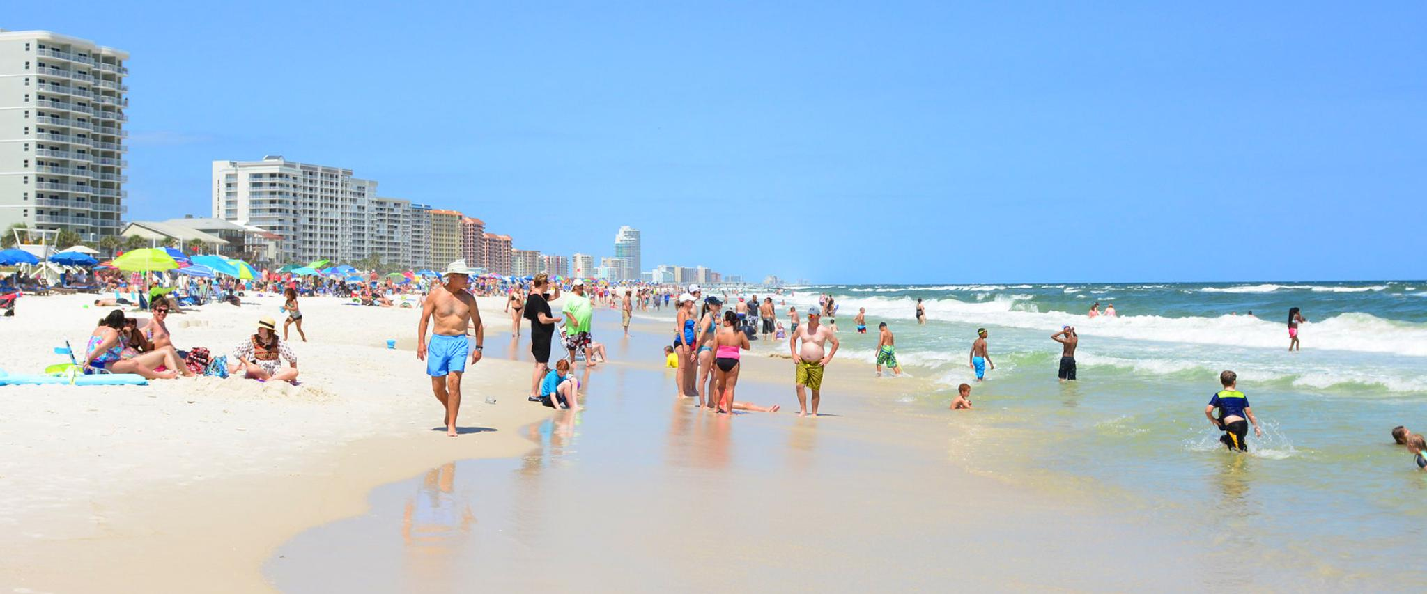 Beach goers enjoy Alabama's white sand beaches