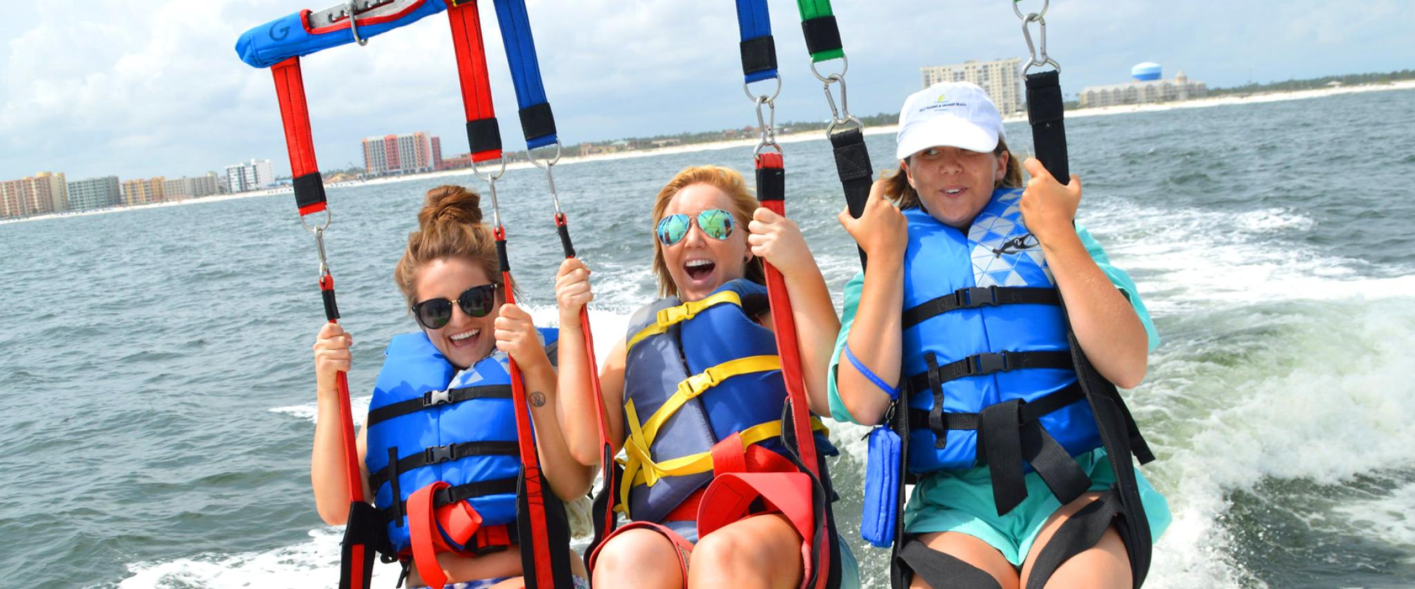 Girls parasailing in Gulf Shores, AL