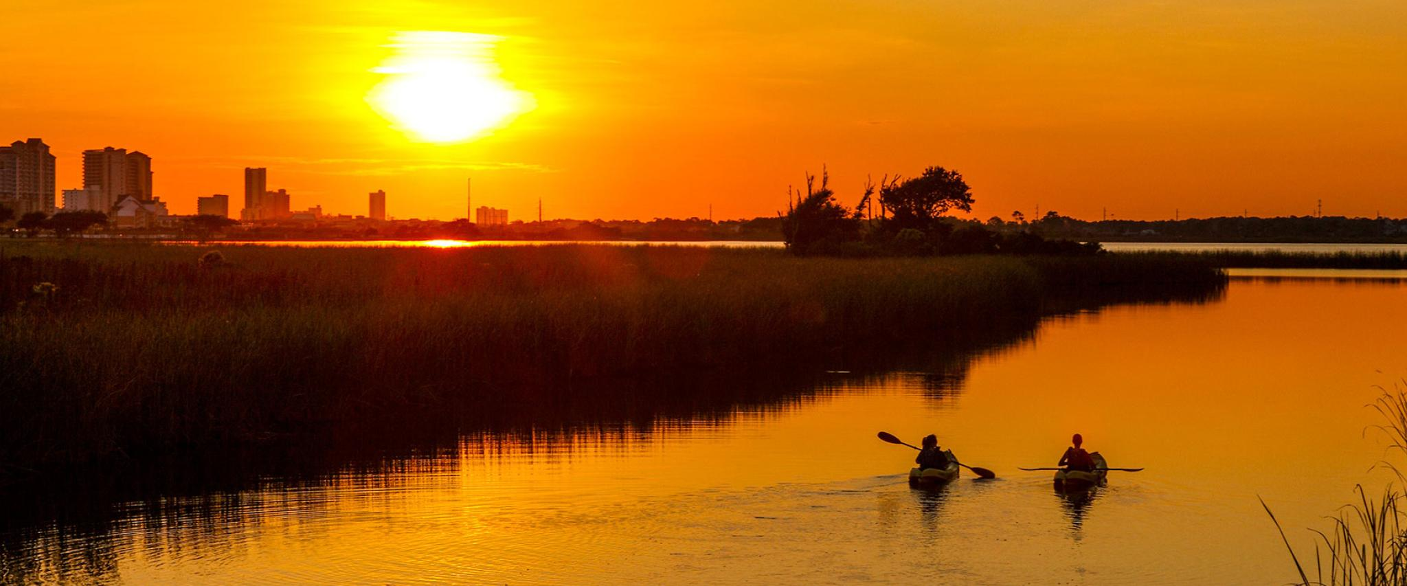 Kayakers watch Sunset in Orange Beach