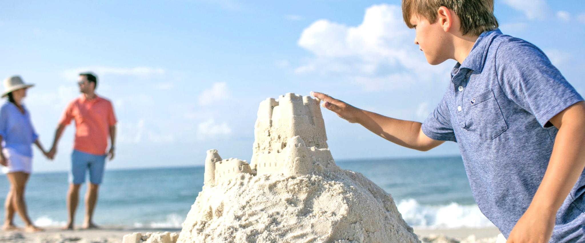 Boy building sand castle on Alabama's Beaches