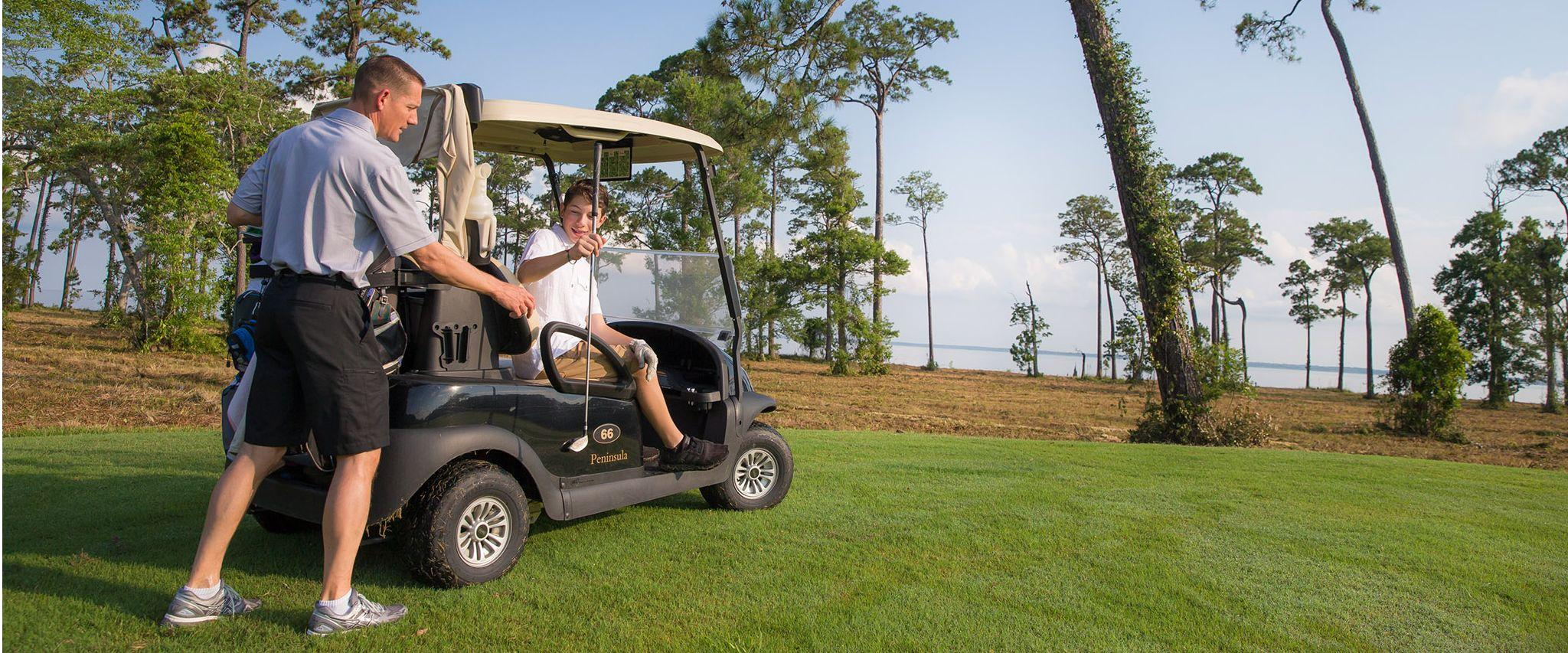 Father and son golfing in Gulf Shores, AL