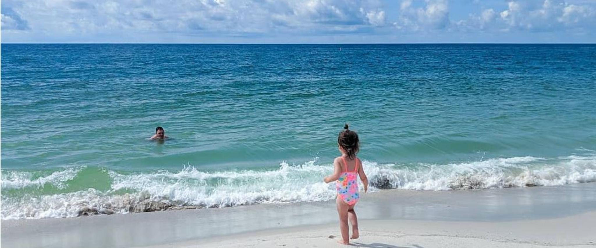 Young girl playing on the beach in Orange Beach, AL