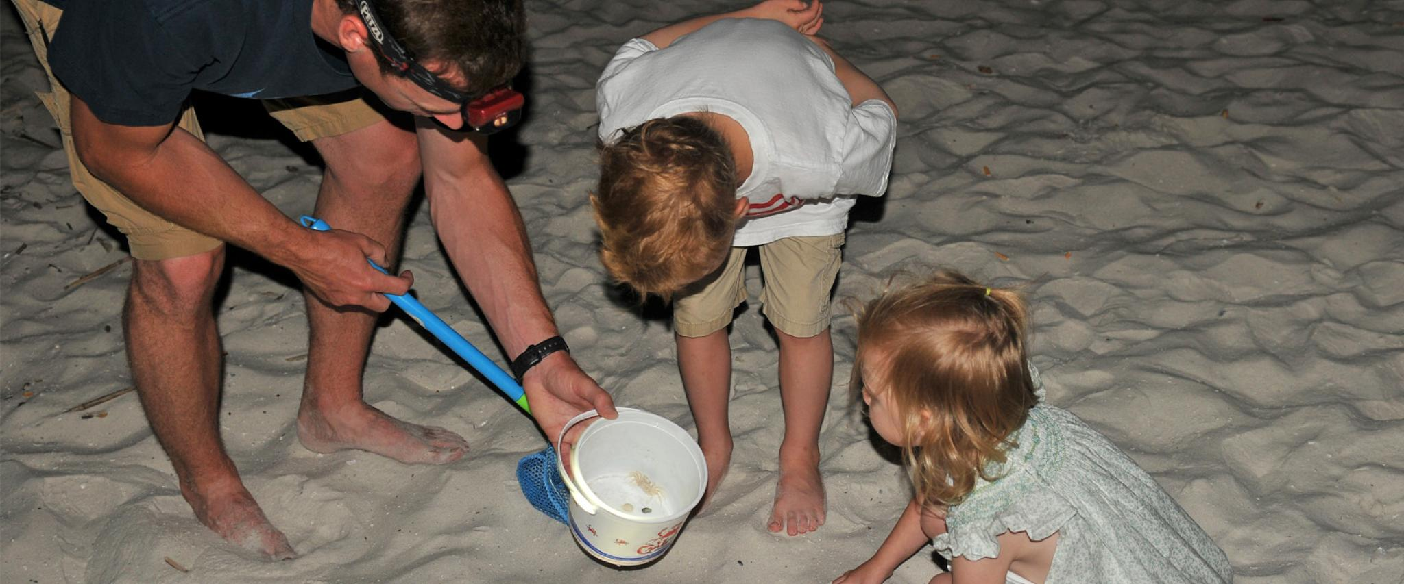 Family crab hunting on Alabama's Beaches
