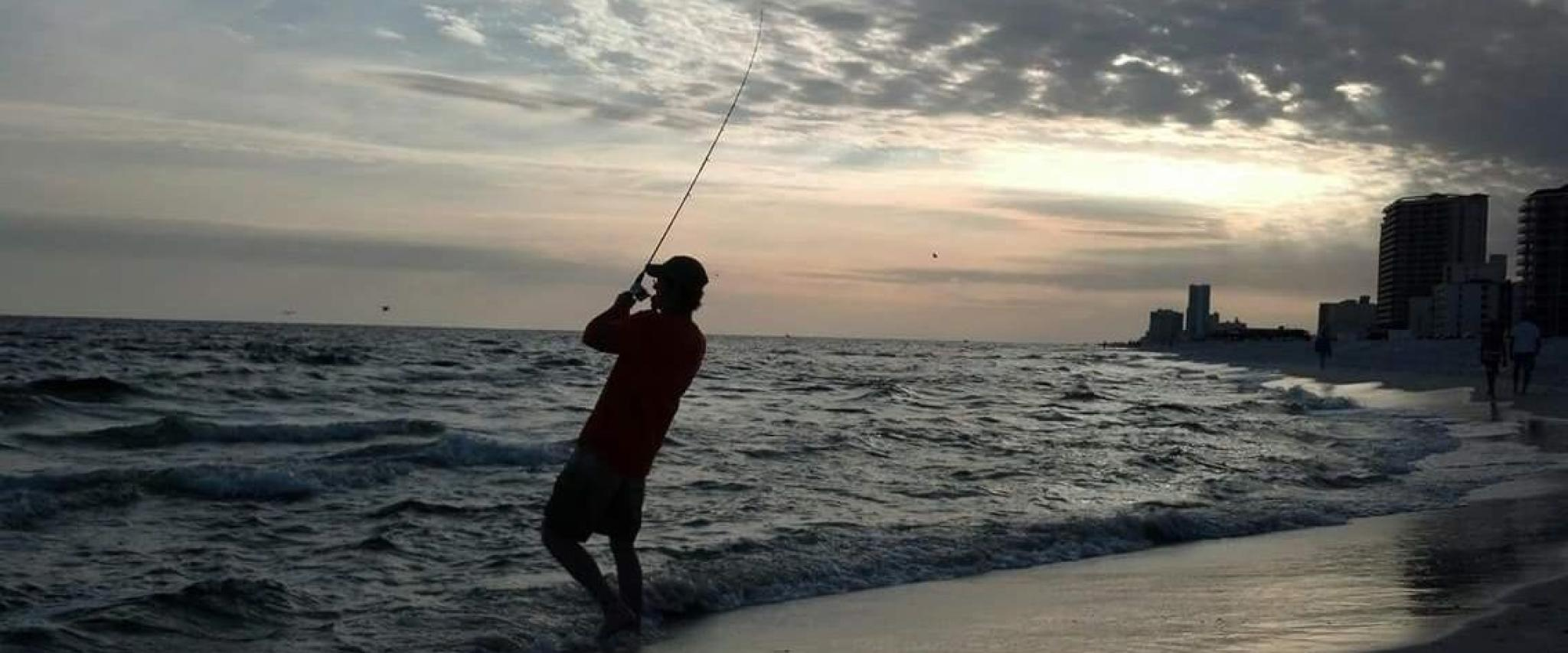 Man shore fishing in Gulf Shores, AL