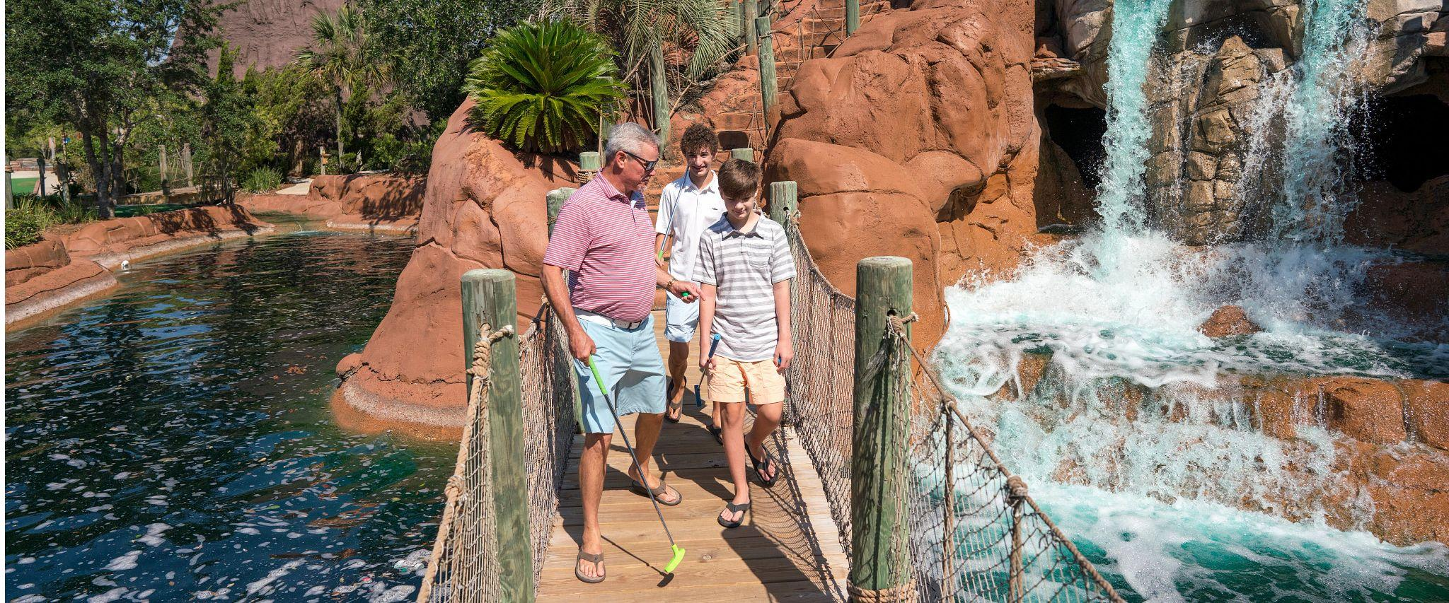 Family playing mini golf at Adventure Island in Orange Beach, AL