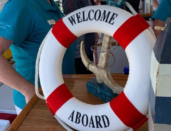 welcome aboard life ring orange beach